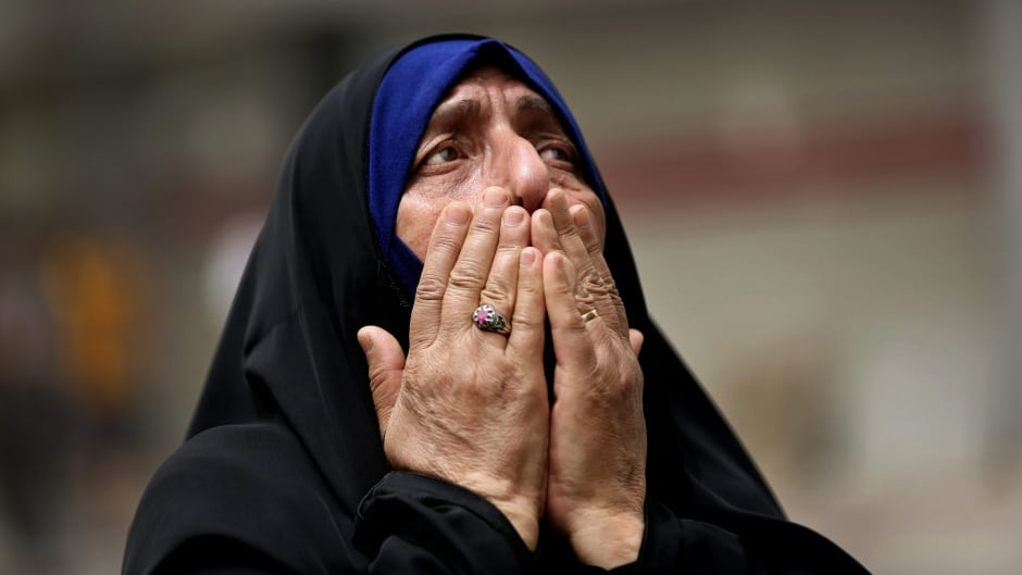 An Iraqi woman grieves at the scene after a truck bomb attack in Baghdad, Iraq, July 3, 2016. More than 200 were killed - the biggest to strike the Iraqi capital in years.