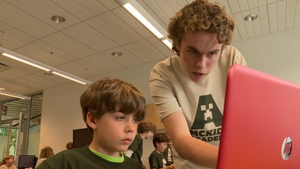Children at MCKids Academy's week-long summer camp learn how to play Minecraft.