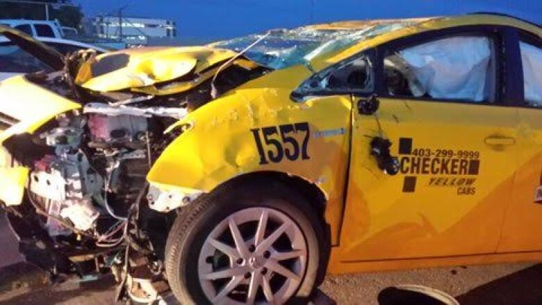 Charges laid after Calgary cab flipped because driver punched unconscious