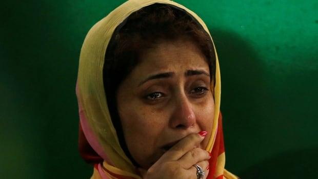 A relative cries on Monday after attending the funeral prayer of the victims who were killed in a deadly hostage-taking at a restaurant in Dhaka, Bangladesh, in June.  ISIS claimed responsibility for the attack.
