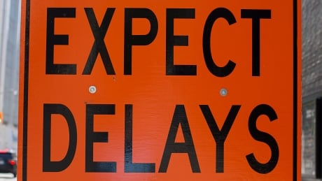 Expect delays road sign delays construction