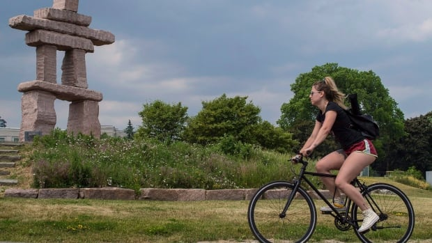 One of the perks of a hot, dry summer: Cycling at Inukshuk Park in Toronto.
