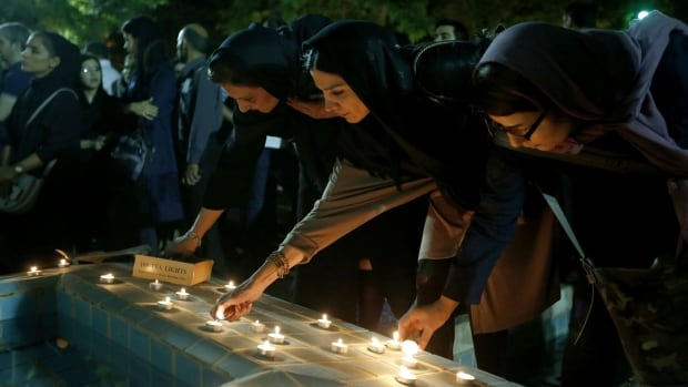 Iranians gathered for a candlelight vigil to honour Iranian film director Abbas Kiarostami at Tehran's Museum of Cinema on Tuesday. The filmmaker, acclaimed as a 'towering figure' in world cinema, died in France at the age of 76.
