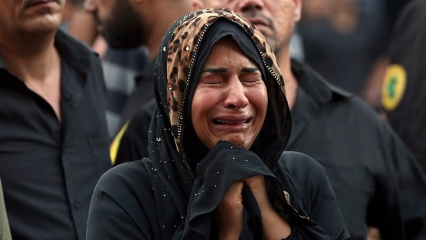 A woman grieves during the funeral procession of a bomb victim in the Karada neighbourhood or Baghdad on Tuesday as further victims are still being recovered from the site of the weekend suicide bombing.