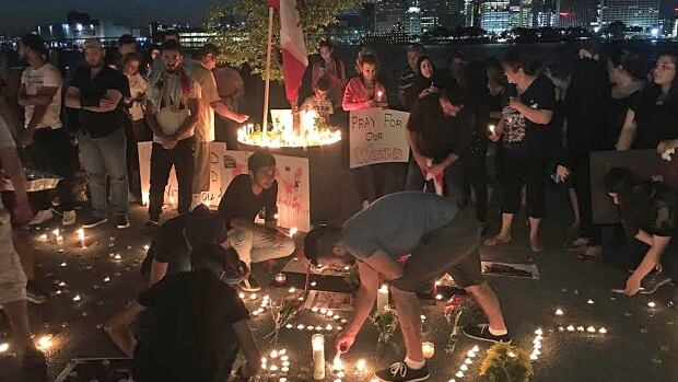 Hundreds gathered on Windsor's waterfront Tuesday nigh to remember those killed in a bombing in Iraqi this week.