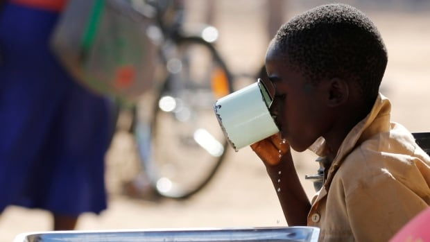 A child takes a drink in drought-hit Masvingo, Zimbabwe on June 1. UNICEF says 26 million children in eastern and southern Africa are suffering from the lingering effects of El Nino, with one million needing immediate life-saving treatment for severe malnutrition.