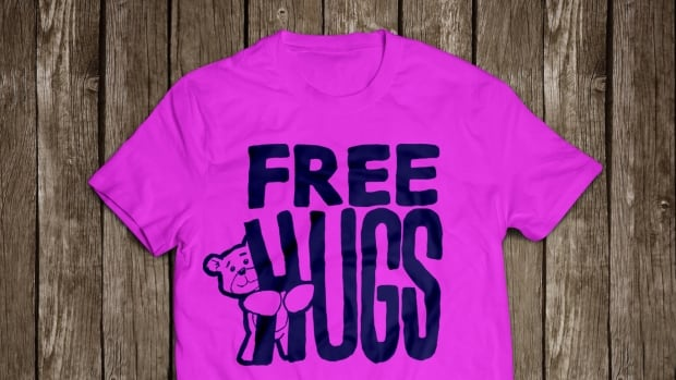 Jeph Maystruck says his students came up with the vibrant design, but he's not opposed to it because if you're walking down the street with a free hugs T-shirt on, all of Regina should be able to see you.