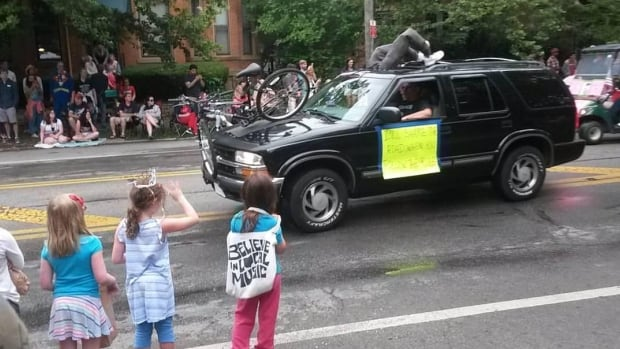 This Doo Dah Parade float of a black SUV pretending to hit a biker has caused controversy in Columbus, Ohio. (Photo submitted by Spencer Hackett)