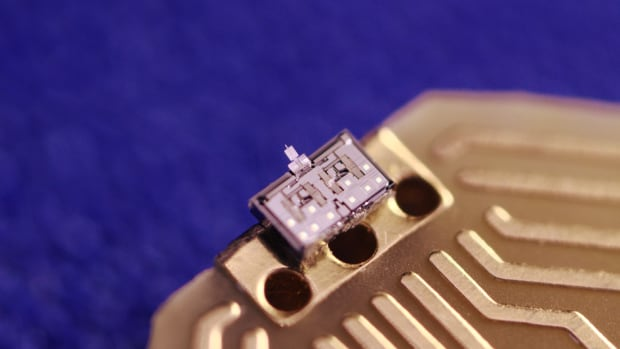 The nGauge microscope is seen here attached to a silicon chip. The Waterloo company behind it hopes to land this product in universities.