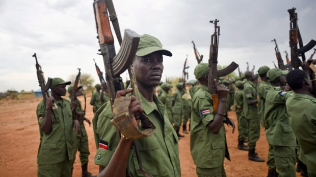 South Sudanese rebel soldiers raise their weapons at a military camp in the capital Juba in April, a few months before the signing of a peace agreement to end the country's two-year civil war.