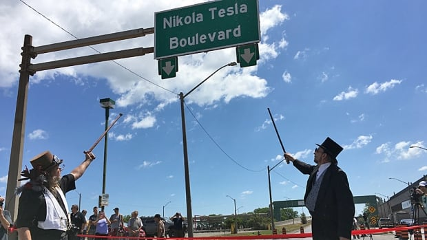 Andy Moses, left, and Victor Starecky, both of Hamilton, dressed in Victorian costume for the unveiling of Nikola Tesla Boulevard. Portions of the road are closed today until 3 p.m.