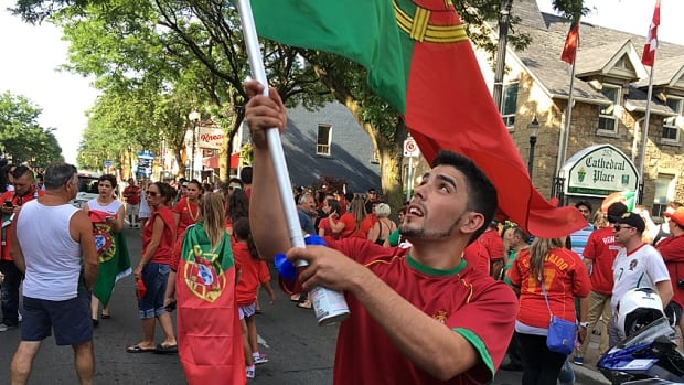 Portugal fans crowd James Street North to celebrate the country's Euro Cup 2016 win.