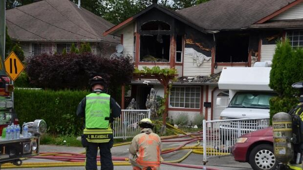 Port Moody, B.C., firefighters say flames were shooting out of this home on Sunday when they arrived.