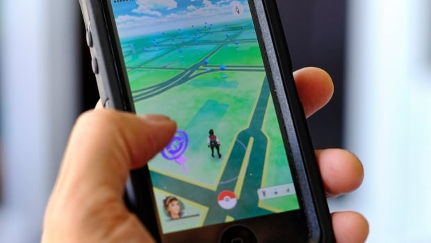 Pokemon Go is displayed on a cell phone in Los Angeles on Friday.  Just days after being made available in the U.S., the mobile game has jumped to become the top-grossing app in the App Store, and given a boost to Nintendo's share price.