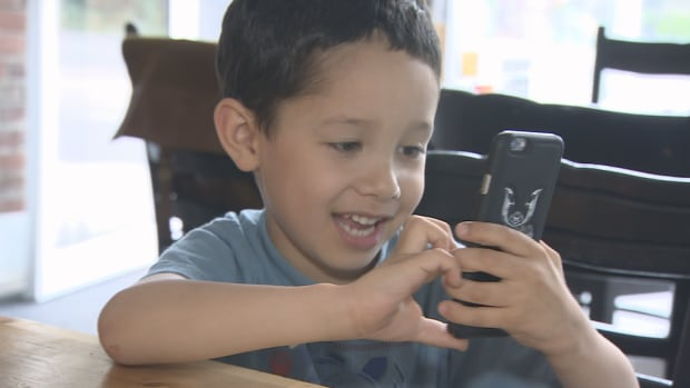 Although Joshua Casino, 6, likes to play Pokemon Go, his father JP says 'he's a bit young for a cellphone.'