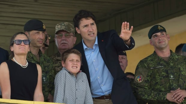 Canadian Prime Minister Justin Trudeau and his son, Xavier, watch a fire demonstration alongside International Trade Minister Chrystia Freeland, left, at the International Peacekeeping and Security Centre near Yavoriv, western Ukraine, on Tuesday.