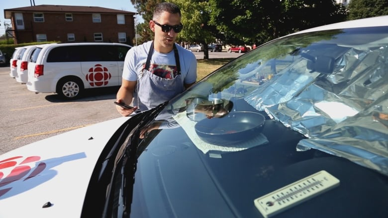 Cooking a meal inside a hot van with chef Johnny Oran   CBC News