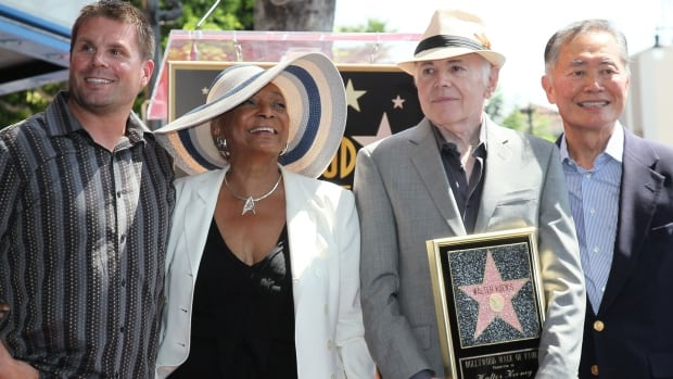 Rod Roddenberry (left), son of Star Trek creator Gene Roddenberry, poses with original series actors Nichelle Nichols (from second left), Walter Koenig and George Takei on the Hollywood Walk of Fame in 2012. Roddenberry said he thinks his late father 'would be 100 per cent in favour of a gay character in Star Trek.'