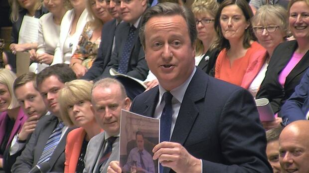 David Cameron holds a picture of Larry the cat July 13 2016