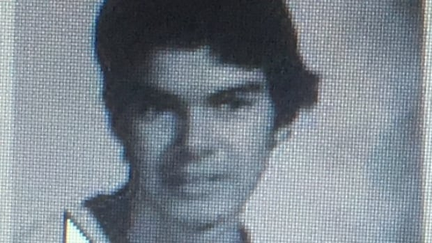 The first glimpse of the face of the masked Anonymous 'comrade' shot dead by RCMP is this yearbook photo of James McIntyre from 1979.