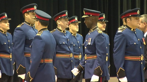 Former Police Chief Devon Clunis inspects new recruits to the Winnipeg Police Service at a 2014 graduation ceremony.