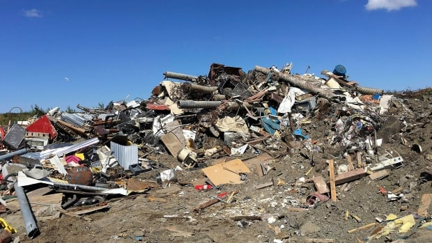 Plenty of perfectly good items can be found at dumps like the one pictured in Bethel, Alaska. On Saturday at the Crane Mountain Landfill, folks can take some of them home for bargain-basement prices.