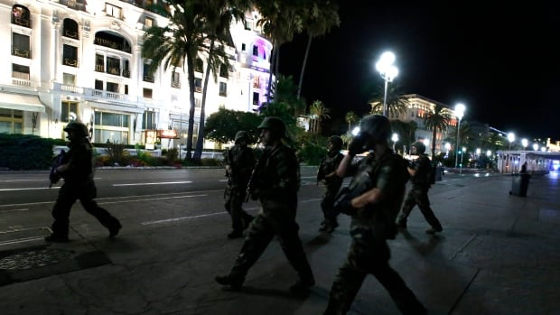 French soldiers advance on the street after at least 84 people were killed in Nice, France, during the Bastille Day national holiday July 14, 2016.