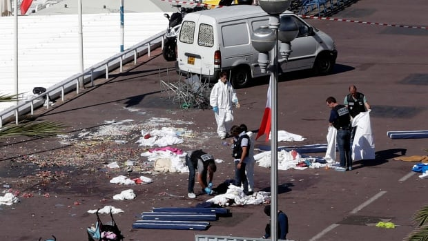 Police researchers inspect the scene where a truck crashed into the crowd during the Bastille Day celebrations in Nice, France. Repeated exposure to these types of images can affect people's sense of safety, a Toronto psychologist says.