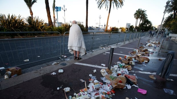 A day after the deadly truck attack on the Promenade des Anglais in Nice that killed more than 80 people, the atmosphere was sombre and debris from last night's tragedy was still scattered on the street.