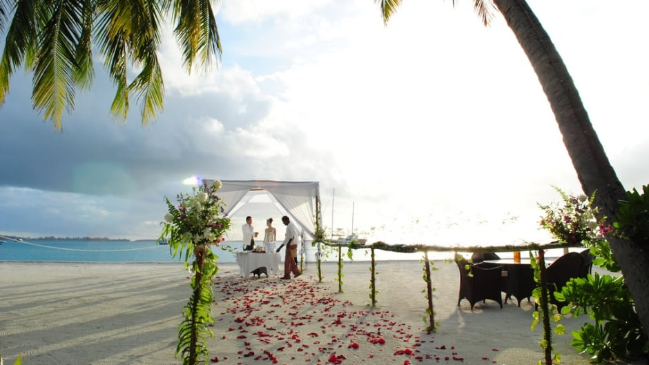 Is it worth escaping to a tropical location to get married, knowing that half of your guests won't make it?