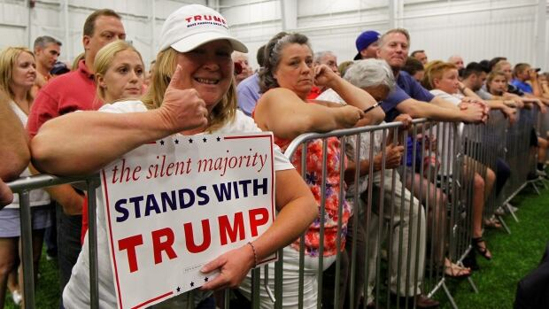 Campaign supporters listen to Republican U.S. presidential candidate Donald Trump address during a campaign stop at the Grand Park Events Center in Westfield, Indiana, July 12, 2016. REUTERS/John Sommers II - RTSHNDN