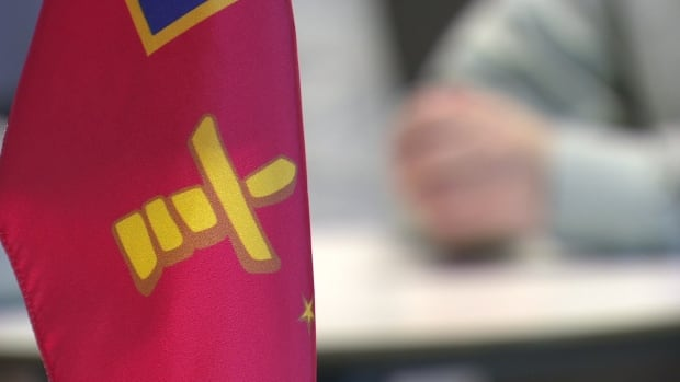 Flags representing Nunavut dot the RCMP's mess hall at its Iqaluit headquarters. A program meant to attract more Inuit to the force has been put on hold.