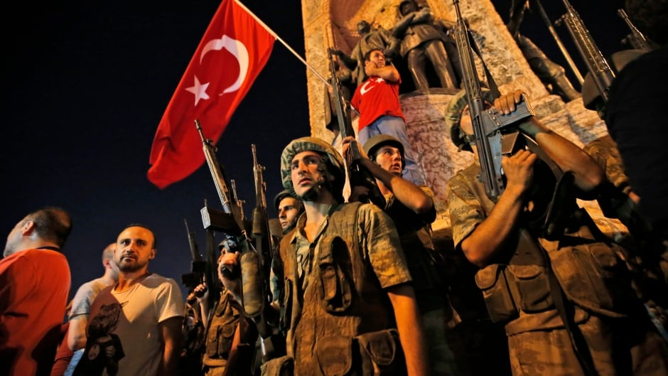 Turkish soldiers secure the area, as supporters of Turkey's President Recep Tayyip Erdogan protest in Istanbul's Taksim square, early Saturday, July 16, 2016.