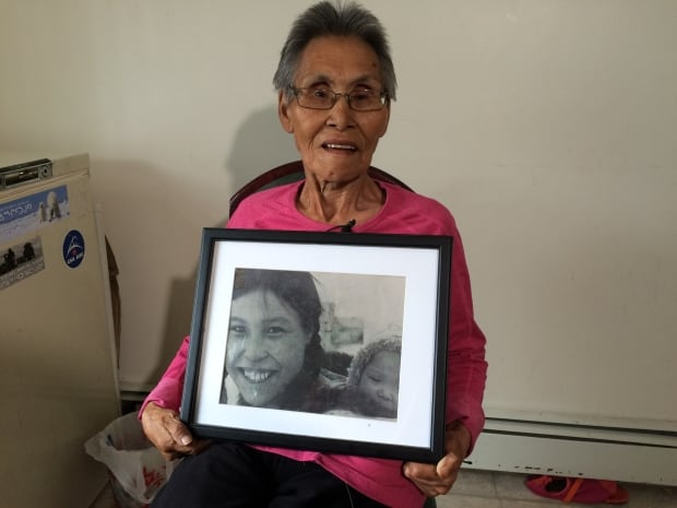 Therese Ukaliannuk holds photo of daughter