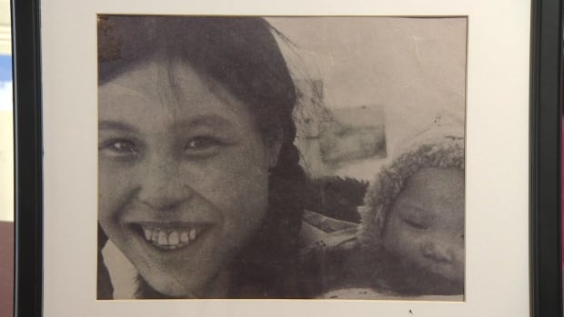 In the only photo Marieyvonne Alaka's family has of her, she pokes her head out of the hood of her mother's amauti. It was taken in 1959 when she was just a few months old. She was sent to residential school in Chesterfield Inlet when she was four and she died at age eight.