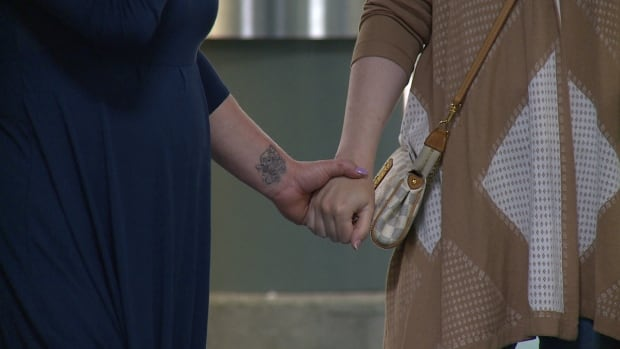 SISTERS HOLD HANDS