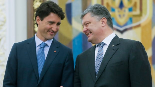 Ukrainian President Petro Poroshenko speaks to Prime Minister Justin Trudeau during a signing ceremony for a free-trade agreement in Kyiv in July.