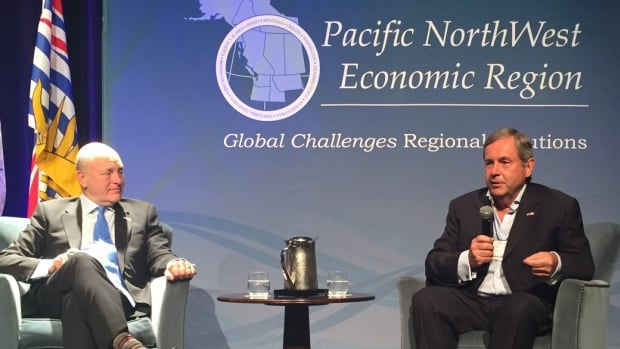 David MacNaughton (right) gave the keynote address, along with his American counterpart Bruce Heyman, at the Pacific NorthWest Economic Region's annual summit in Calgary on Monday.