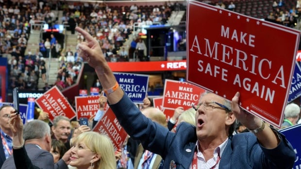 California delegates get fired up during the evening session of the Republican National Convention in Cleveland, Ohio. Other California delegates were relegated to their hotels due to norovirus, officials say.