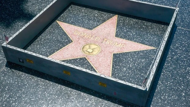 A miniature wall was built around Donald Trump's star on the Hollywood Walk of Fame on Tuesday. It has since been removed.
