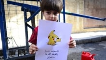 Syrian child holds Pokemon drawing