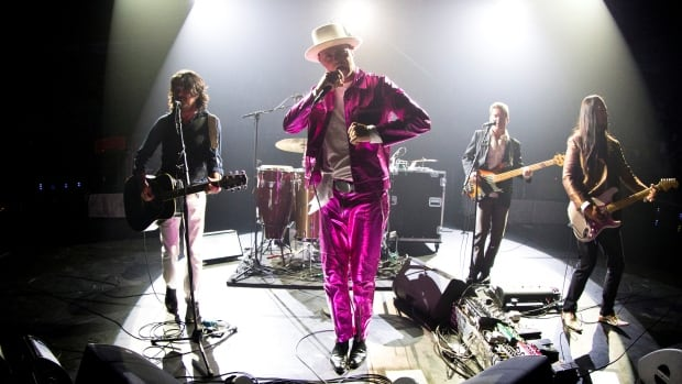 Tragically Hip lead singer Gord Downie performs with band members Paul Langlois, Gord Sinclair, Johnny Fay and Rob Baker at the Save-on-Foods Memorial Centre to kick off the band's latest Man Machine Poem tour in light of Downie's brain cancer diagnosis, in Victoria, B.C.