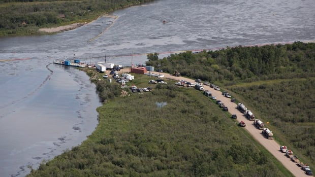 """A series of booms were deployed this summer, to handle Husky's broken pipeline which leaked more than 200,000 litres of oil diluent into the North Saskatchewan River. The company called the break a """"sudden, one-time event"""" caused in part by heavy rain along the south riverbank."""