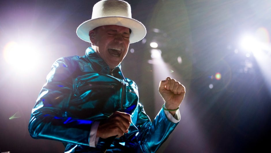 Frontman of the Tragically Hip, Gord Downie, leads the band through a concert in Vancouver, Sunday, July, 24, 2016.