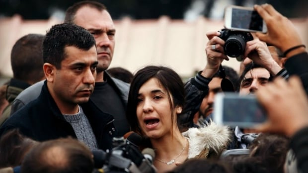 Murad Ismail, left, and Nadia Murad Basee Taha tour a refugee camp in Greece in April 2016. They also visited Ottawa to campaign for Canada to resettle Yazidi refugees.