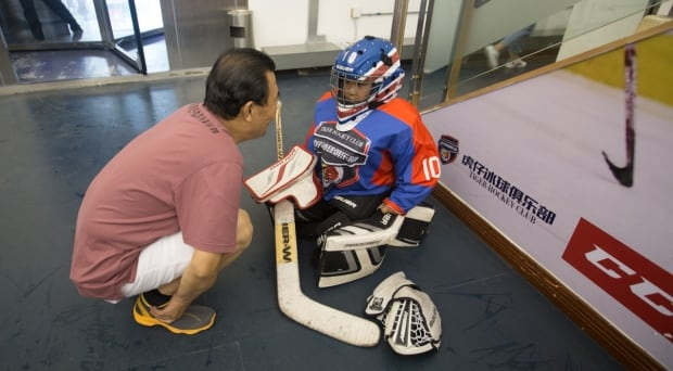 China Canada hockey parents children sport