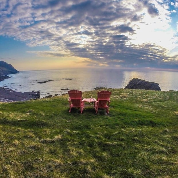 Green Gardens red chairs Gros Morne