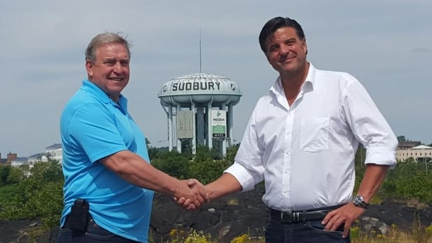 Gates Perreault, the father of Jeff Perreault, stands with Dario Zulich, the new owner of the Pearl Street water tower in Sudbury.