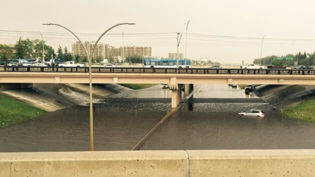 A car is stranded in a flooded part of the Whitemud on Wednesday afternoon.