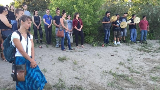 People gathered in Saskatoon along the South Saskatchewan River to express concern about the waters of the North Saskatchewan River. Husky Energy reported a pipeline leak near the North Saskatchewan last week led to some 200,000 to 250,000 litres of oil entering the water.
